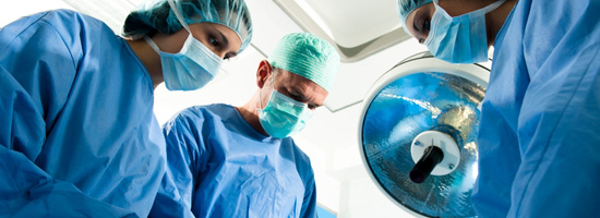 A group of surgeons operate on a patient